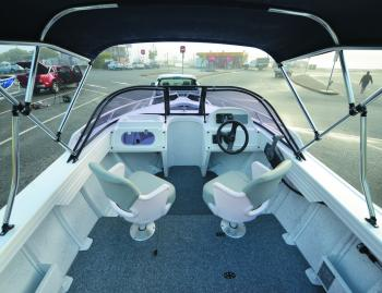 The helm seats swivel 360° to be useful for fishing and driving. The bimini top is an optional extra that can be ordered and fitted at the factory.