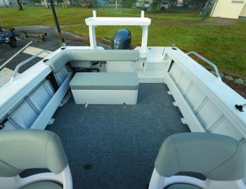 Now that's a lot of workspace for a 4.8m boat. The rear lounge folds over as required and the transom door makes loading from the stern pretty easy.