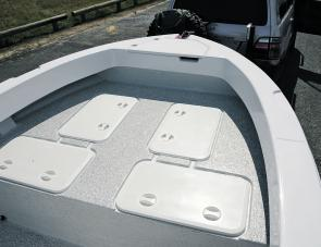 An elevated casting deck isn't flush with the gunwale. Later models have customised hatch covers.