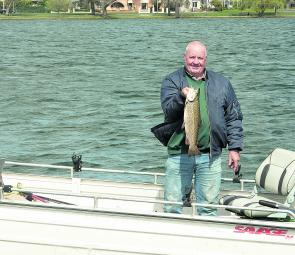 Brian Rivett with a Lake Wendouree brown trout caught on mudeye.