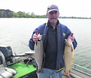 Daryl Ramsay from the Williamstown Anglers Club with a couple of lovely brown and rainbow trout.