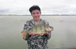 Daniel Hon with his Lake Burrumbete redfin caught on worms. Photo courtesy Craig Hon