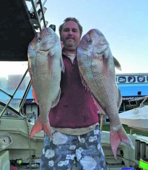 John Tanzen displays two of his three winter snapper from Corinella.