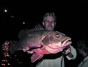 Gus Nowell with a thumping after dark mangrove jack.