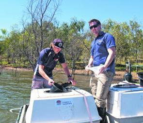 Luke Vandenberg and Brendan Findlay from DPI Port Stephens hatchery acclimating bass fingerlings prior to releasing into Glenbawn.