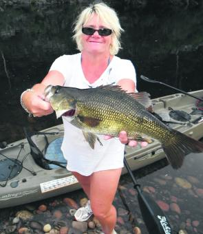 Maddy Loader with the family trophy fish of 47cm that ate a spinnerbait bounced down a deep rock face.
