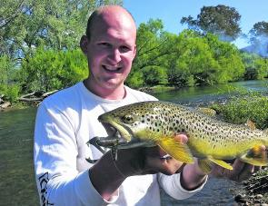 Brenton Richardson with a ripper of a Kiewa River brown trout caught recently on a Strike Tiger 3