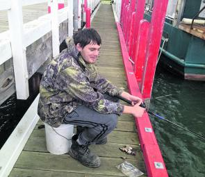 Local fisherman David trying his luck off the Port Welshpool jetty.