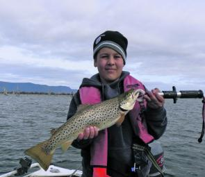 Curtis Vanstan with an average size brown trout from Lake Fyans taken on a mudeye.