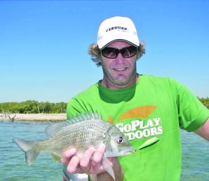 Adam with his first surface bream – the Ecogear PP60F.