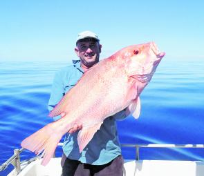 Ian Garret with a 105 cm scarlet caught over the hoidays.