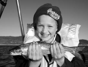 Annika Cavanagh of Young with a small Atlantic salmon trolled up on Lake Jindabyne. Let's hope the Gaden Hatchery again releases some of its 10kg-plus ex-brood salmon this Winter!