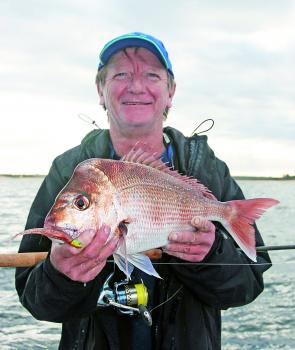John Rattenbury looks pretty happy with a 2kg red on a plastic.