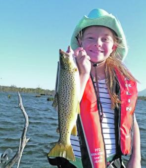 Madison Jeffrey with a splendid brown trout taken in Lake Fyans.