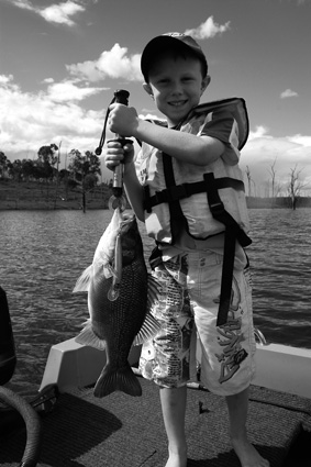 Hayden Medcalf with a bass taken on a Halco Scorpion in Monduran while chasing barra.