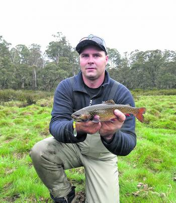 Colin Robinson with a beautifully marked brook trout – one of dozens he has slayed on the Bling spins this season.