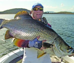 Phil Lyons with a huge Kinchant Dam barra. This is the fish dreams are made of for most anglers.