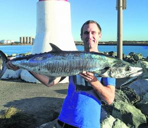 Rob Sabbage proudly displays his 11kg Spanish mackerel caught from the end of the Mackay harbour breakwall on one of the new Rapala lures that is now becoming one of his favourites.