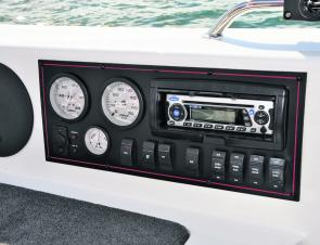 Engine gauges, switches and the audio system all reside in this neat panel on the port gunwale.