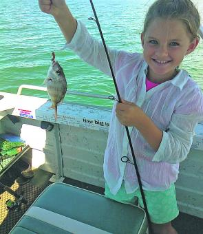 Emily Thompson of Petrie caught her first juvenile snapper on dad's new boat.