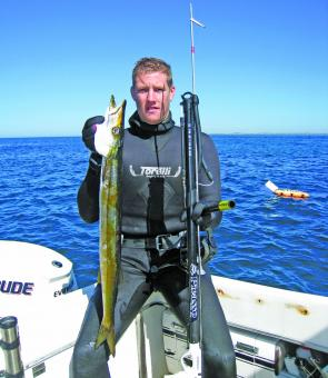 Victorian spearfishing Champion Drew Fenney and a snook.