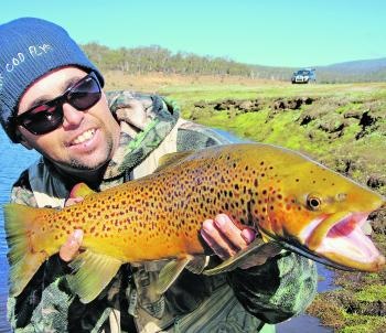 The Eucumbene River will be super popular this month with thousands of trophy-sized brown trout like this on offer. Vehicles in the background of shots like this will be a thing of the past now due to the new car park at Denison restricting anglers from d