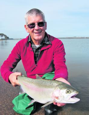 Ross Winstanley with a stunning Lake Burrumbeet rainbow trout. Photo courtesy Mark Ainsworth.