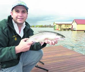 Shane Stevens with a typical Lake Wendouree rainbow trout caught on Powerbait.
