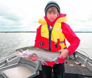 Jack Cunningham with a marvellous Lake Tooliorook rainbow trout. Photo courtesy Rod McNeight.