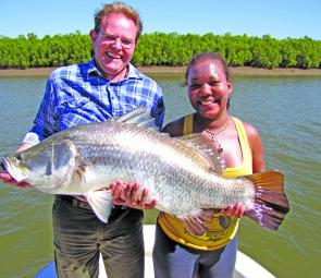 A pair of anglers more than happy with this barra while fishing with Aussie Barra Charters.