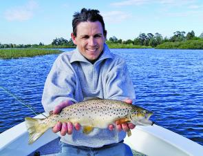 Mal Stevens with a great brown trout taken loch style fishing on Lake Wendouree.