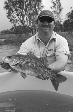 Dave Bullard with the bass that won him the Big Bass at the Isis Balancing Storage BASS Electric event at Bundaberg.