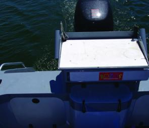 There's tackle storage behind the sliding door under the bait board and heaps more storage in the transom – batteries are under the console. The centre plumbed live-bait tank is 60L.
