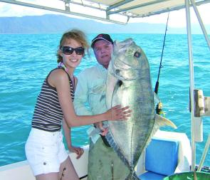 Steffie Paas from Germany had to call on John Wedrat to help her land this monster GT off Double Island near Cairns.