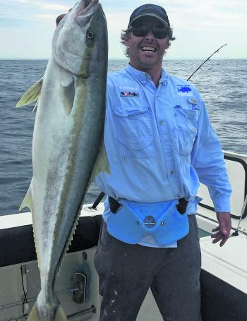 Josh Laws with a 98cm kingfish.