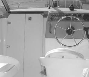 The fold back, lockable, cabin door gives good access to a roomy cabin fitted with a Porta Potty. The factory fitted dash has all switches clearly marked and there is a stack of room to add marine electronics.