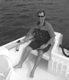 The large rear quarter seats come out to offer an excellent fishing position at the stern and making it possible to comfortably fish four. Note the through gunwale rod holder in trolling position, the four shot rocket launcher on the front of the engine w