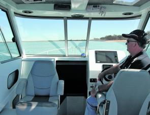 Mr Sea Jay, Col Glass, at the helm of the big 6.8 Pursuit. Note the smart use of the cockpit roof area for radio and electronics installation.