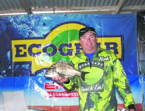 Team Hurricane's Kevin Tormy displays the 1.35kg bream that won his team the Eco-Gear Big Bream.