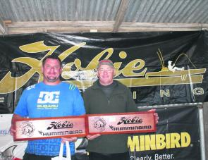 Dean Truman and Sean Kennedy of Team Whitehead Timber Sales display the champions trophies to the crowd.