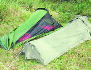 You will greatly benefit from a fly over any camping area, especially a quickly erected sleeping arrangement like this one.