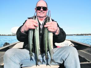 Ken Henderson with some of the garfish that arrive in Georges Bay at this time of year.