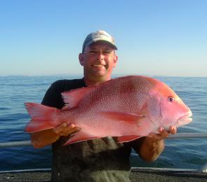 Frank is a fishing machine! Here he is with another great catch of red.