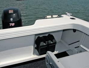 The elevated transom shelf keeps sees the battery out of harm's way and there's easy access to the fuel system.