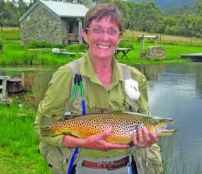 Nadine Lindsay with a brown trout caught on fly at Moonbah Hut, on the Moonbah River