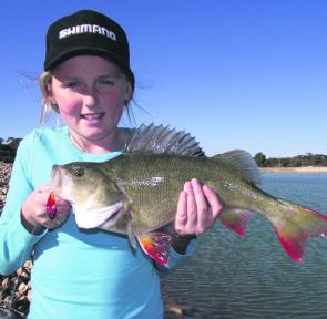 Macey Evans holding a thumper of a redfin caught on a Koolabung Blade.