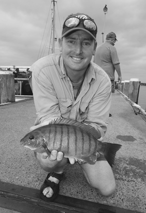 Local angler Craig Owen with a typical Greenwell Point wharf blackfish.