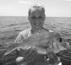 Rebecca Finney with a plate-size red. Outside is producing some good snapper fishing and it'll get better as it gets colder.