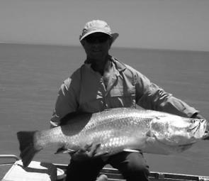 The author cradles a large saltwater barra of 116cm before releasing the fish on a memorable gulf barra trip. The barramundi were taken in shallow water on a trolled gold coloured F18 barra classic.