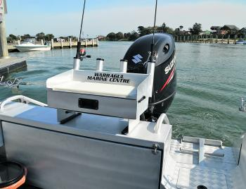 The 611 McLay boasts one of the most practical and well-designed transoms we've seen on an aluminium boat. The transom door is a simple, slide-in piece of aluminium, handrails are in all the right areas and the live bait tank forms part of the step.